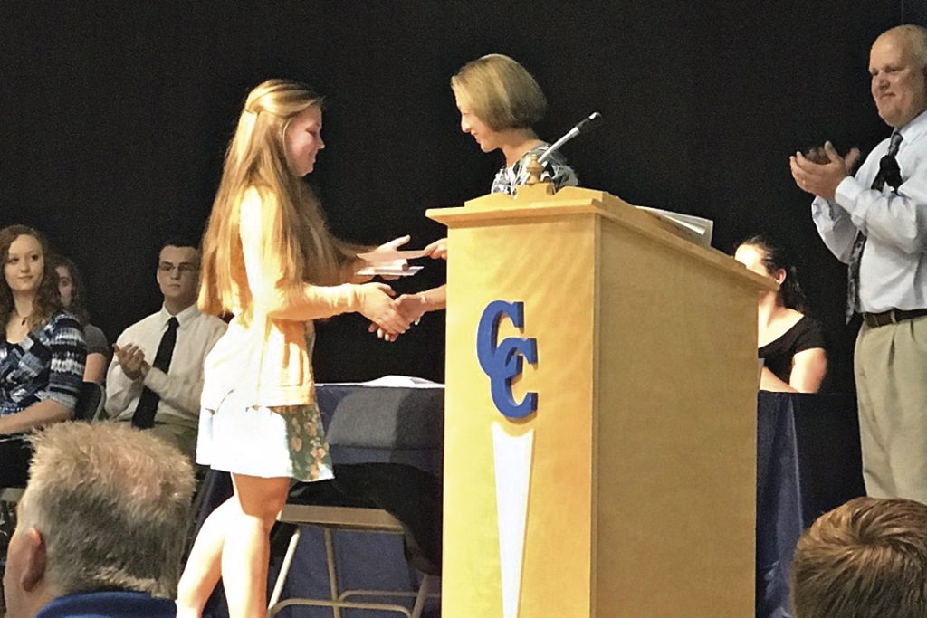 girl accepting scholarship